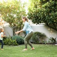 daughter and mother playing in backyard