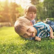 kids playing in green grass